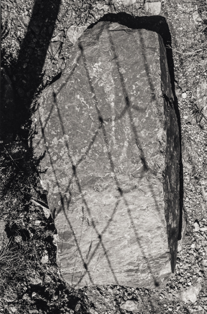 Shadow of wire on Stone.